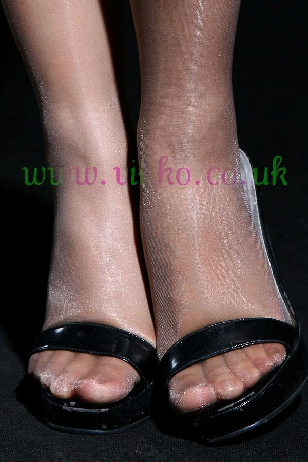 Tan sandles and pantyhose