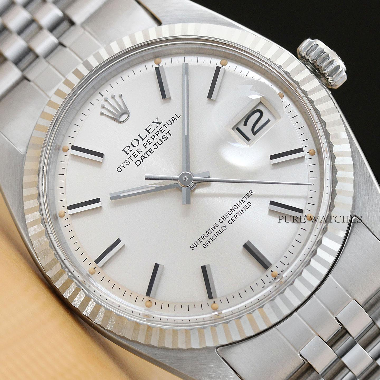 62028359c8741 This is an authentic Rolex watch with a Rolex silver dial, and a Rolex 18k  white gold fluted bezel, and a custom stainless steel jubilee band.