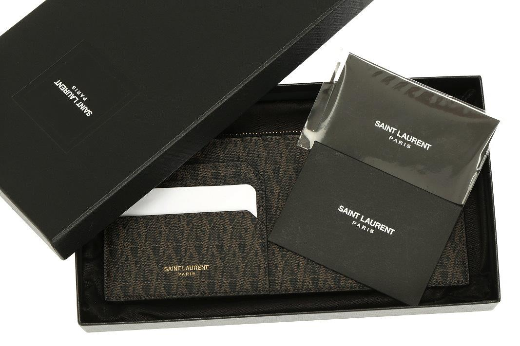e7926c019bd LUXURY QUALITY SIGNATURE YSL PRINT GRAINED 100% LEATHER, TOP ZIPPER  CLOSURE, EXTERIOR CREDIT CARD HOLDER WITH 3 CREDIT CARD SLOTS. SIZE 8.25
