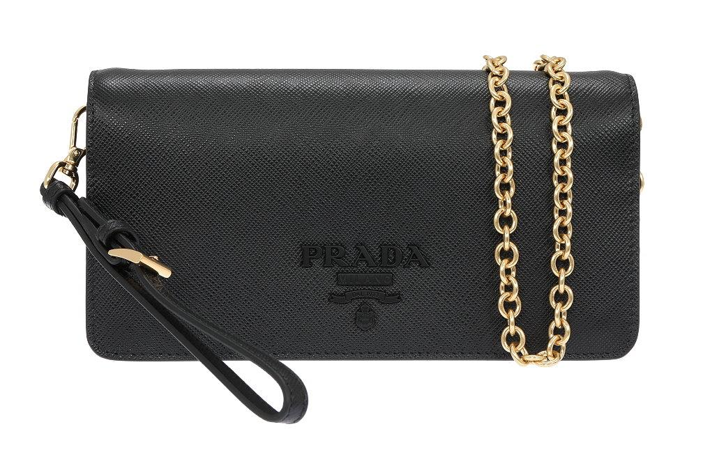 4cf73bdad202 INSIDE BLACK SAFFIANO LEATHER LINING, ON ZIPPED POCKET, 2 CREDIT CARD  SLOTS. DETACHABLE GOLD TONE CHAIN, ADJUSTABLE AND DETACHABLE WRIST STRAP.  BAG SIZE ...