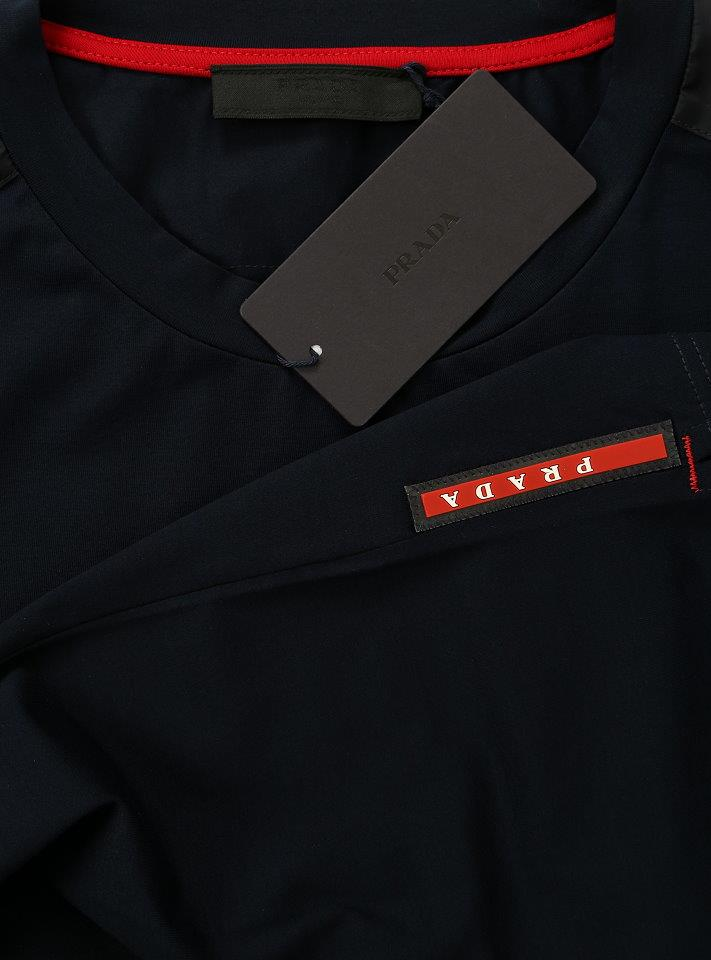 8cd7c46e0 ... SHIRT IN A BLUE COLOR, SIGNATURE RED PRADA LOGO STRIPE ATTACHED ON THE  SIDE. CREW NECK CUT, SHORT SLEEVES.SHOULDERS AND POCKET 100% POLYAMMIDE  INSERTS.