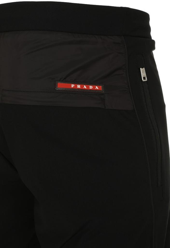 781b63cf3bba HIDDEN POCKET AT THE BACK WITH SIGNATURE RED PRADA LOGO STRIPE. SIZE LARGE.  WAIST 32 . RISE 13