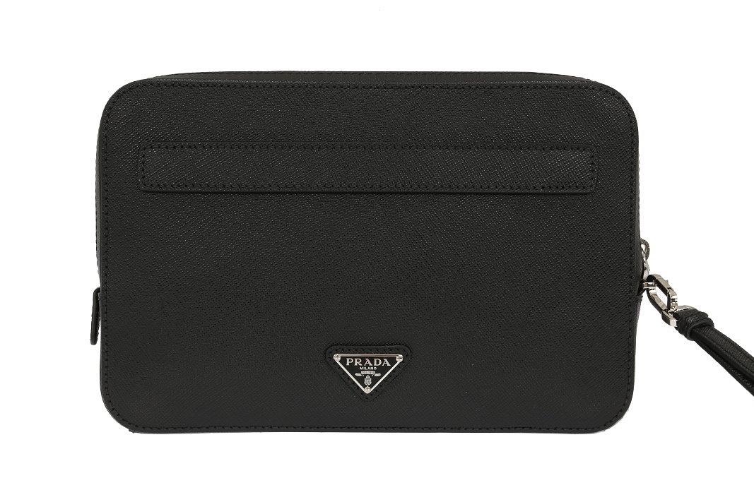 PRADA TRIANGLE LOGO ATTACHED. TOP DOUBLE ZIPPER CLOSURE. ADJUSTABLE WRIST  STRAP. INSIDE ONE RAGE ZIPPED POCKET. 6 CREDIT CARD SLOTS. SEPARATE  COMPARTMENTS. b3be391aebf2e