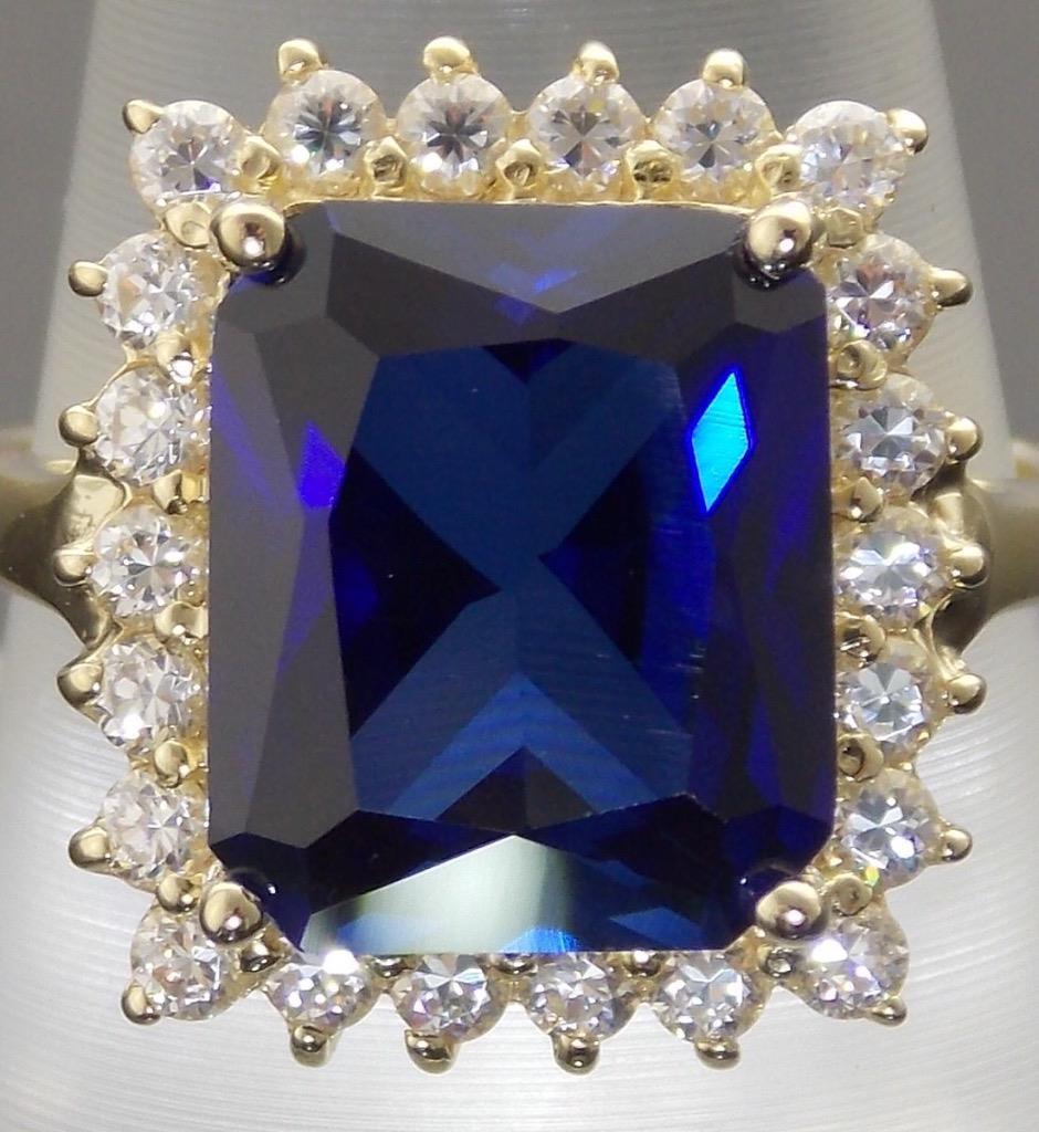 14k gold princess diana style emerald cut blue sapphire