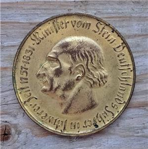 coin rubbing deutsch