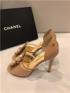 7f7e01da1151 Description. CHANEL 2017 (17P season). Beige (nude) patent leather open toe  heels with faux pearl embellished camellia ...
