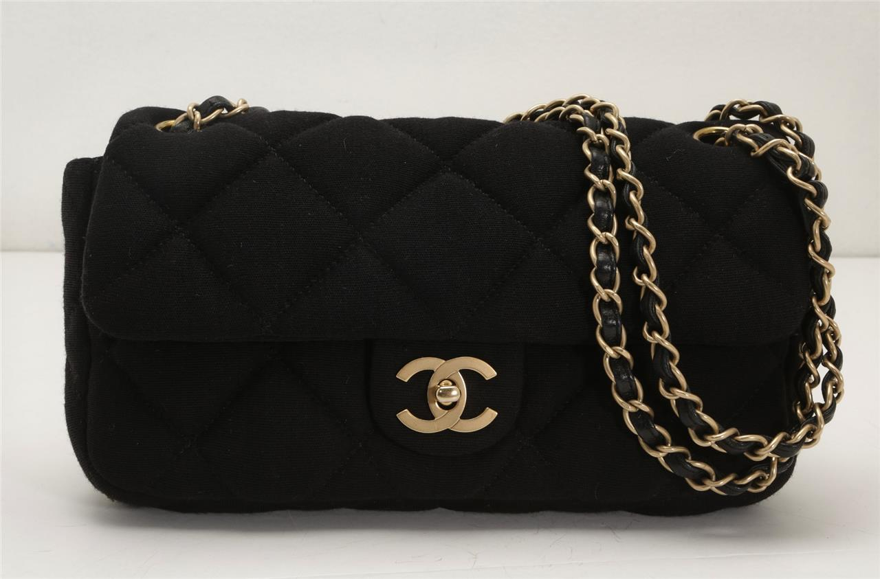 49cf92cc74c82 CHANEL Black Quilted Jersey Knit Gold CC Chain Small Flap Purse ...