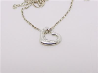 Tiffany co elsa peretti sterling silver open heart pendant lb this beautiful open heart pendant is an authentic tiffany co elsa peretti piece stamped in the back tiffany co elsa peretti 925 spain aloadofball Images