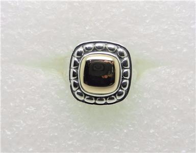 this beautiful ring is an authentic james avery piece in sterling silver and yellow gold stamped with the candle sticks ja ster 14k 9v7 and the letter k