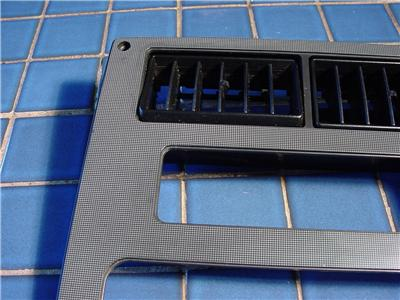 84 88 Fiero Dash Console Radio Trim Bezel w Vents Dot Matrix Grey and Black Nice