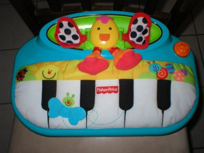 Fisher Price Miracles Milestones Peek A Boo Piano Baby Crib Toy
