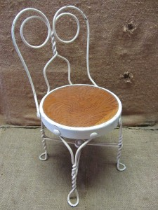 Vintage Childs Ice Cream Chair. It Is Made Of Wrought Iron. The Seat Is  Wood. The Chair May Be Disassembled For Shipment. Very Ornate! Get Creative!