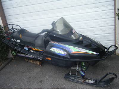 THIS IS A HANDLEBAR COVER OFF OF 1998 ARCTIC CAT COUGAR 550 MOUNTAIN SNOWMOBILE IT IN GOOD CONDITION WITH NO CRACKS OR MAJOR SCRAPES