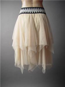 0087130aa Romantic and ethereal in light-as-air tulle, this skirt is the epitome of  delicate femininity. Rendered in a pristine shade of ivory ...