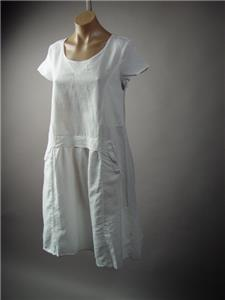 512fe03a0a This dress evokes rustic femininity with its pristine aesthetic. Crafted of cotton  blend