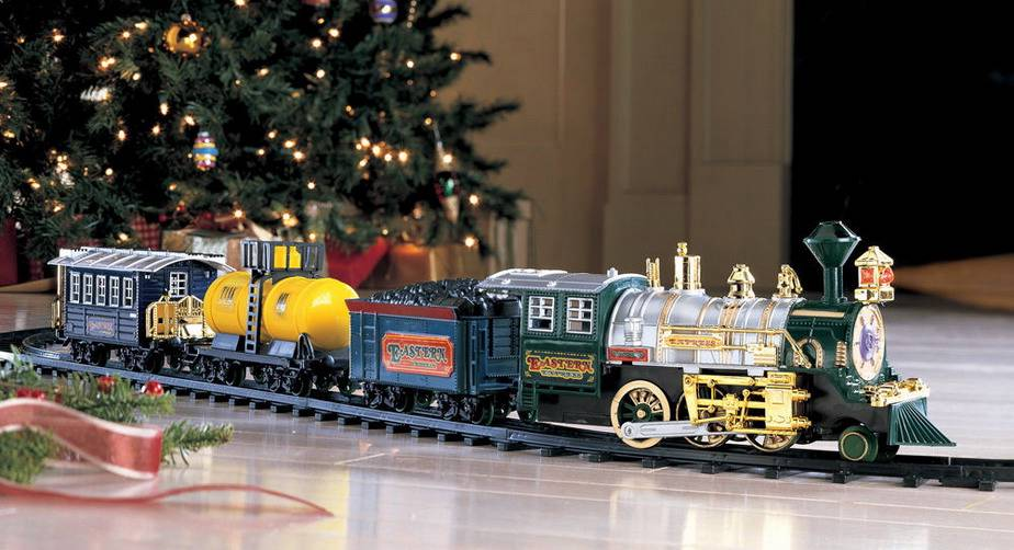 this deluxe choo choo train chugs its merry way around your christmas tree into your heart the locomotive headlamp lights and the chimney smokes while