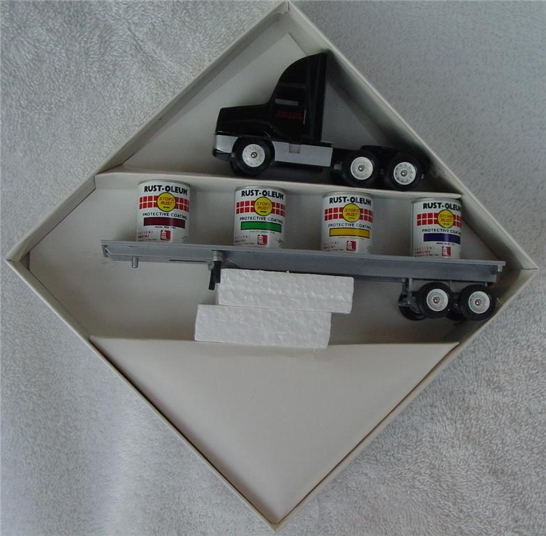 Winross - Intl 8300 Rust-Oleum Black 4 cans on flatbed JCP