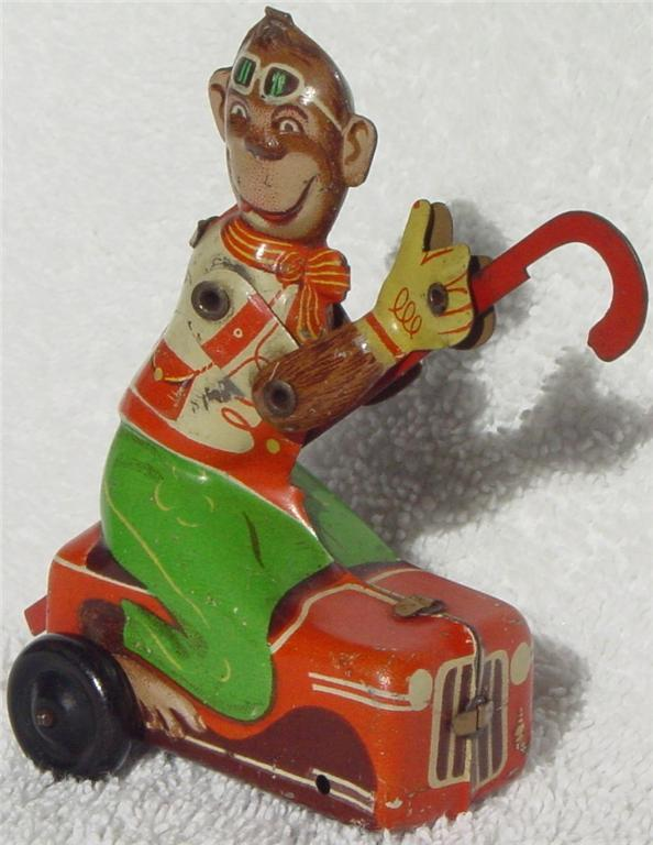 Windup - FH Monkey on little car USZ 3-4 no key -front axle