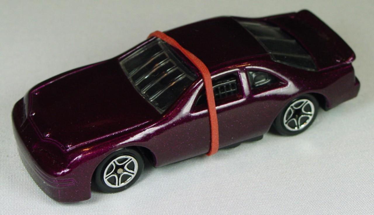 Pre-production 07 G - Ford T-Bird dark metalflake Grape black interior unspread rivet made in China