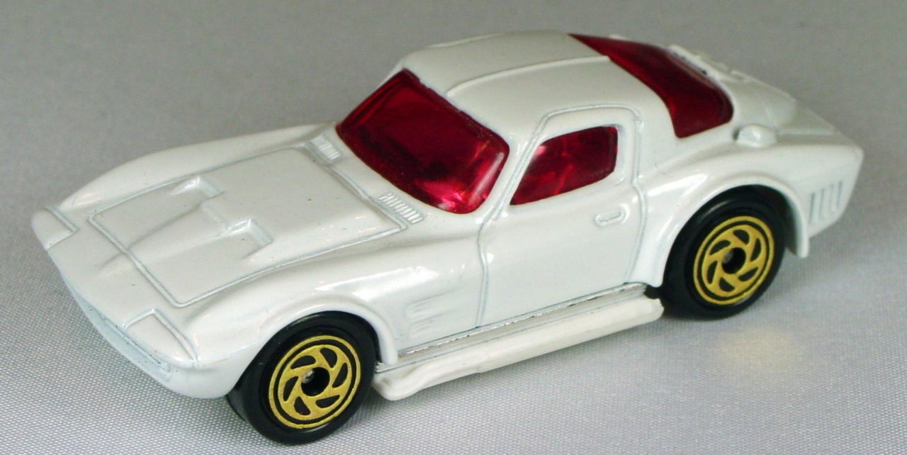 Pre-production 02 G - Vette Grand Sport White pink window 6-spk spiral gold made in Thailand